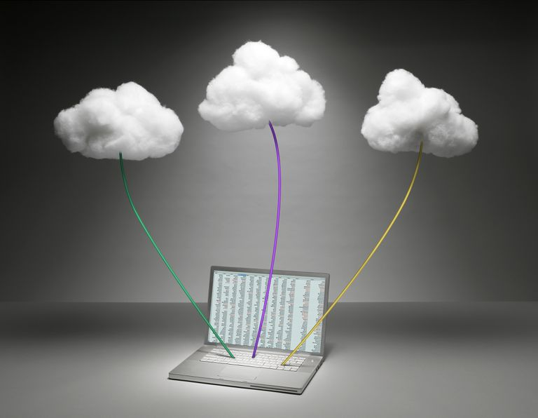 3D clouds attached to a laptop by different colored rods