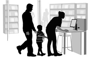 a family looking things up on a library computer