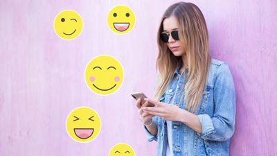 A Telegram user wearing sunglasses using emoji stickers on a smartphone.