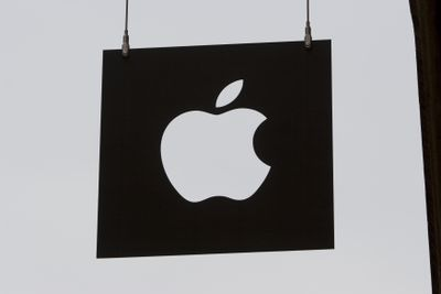 Sign hanging outside for an Apple Store