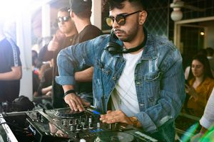 DJ spinning on gear at concert