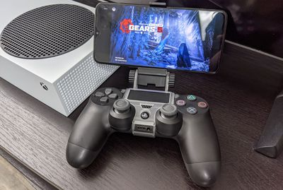 A PS4 controller playing an optimized for Xbox Series X|S game on Android with Game Pass.