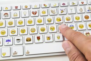 A keyboard with emoji keys