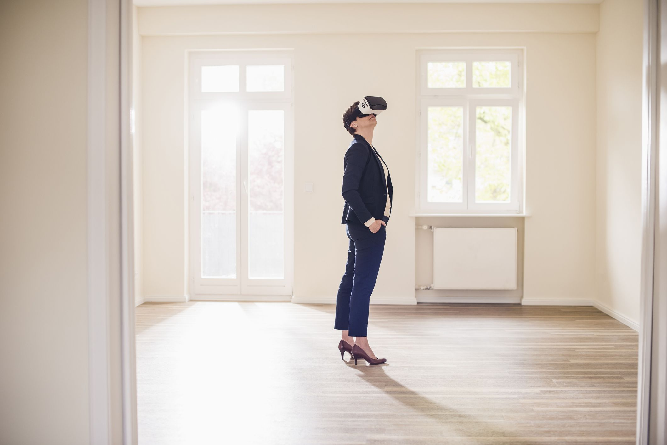 Someone looking around an empty apartment wearing VR glasses.