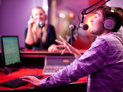 Radio DJs broadcasting in a recording studio