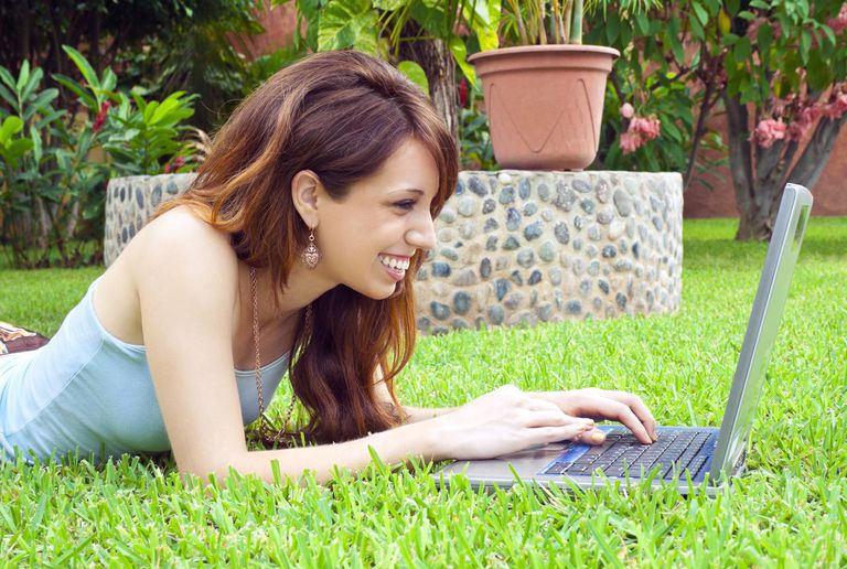 A young woman with a computer.