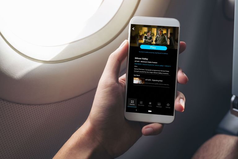 A man watches HBO Now offline on a plane.