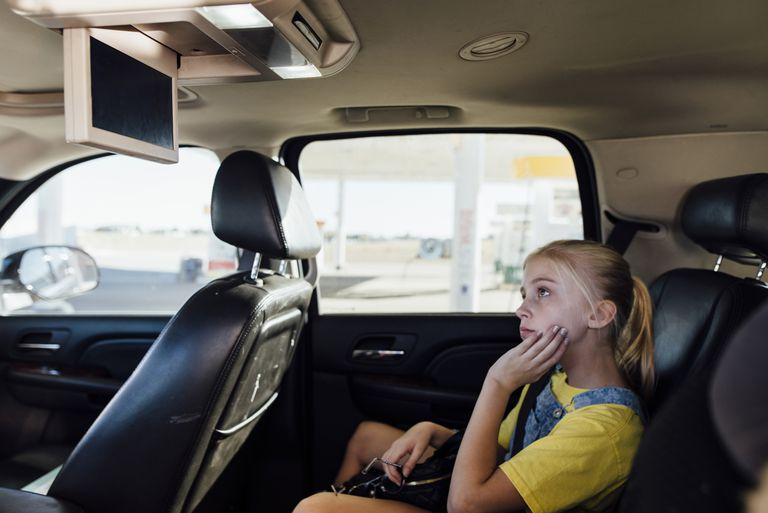 A girl streams television in a car.
