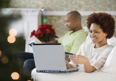 Woman buying Christmas presents online with credit card on Free Shipping Day 2019