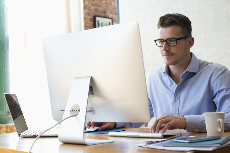 Businessman sitting at desk using laptop