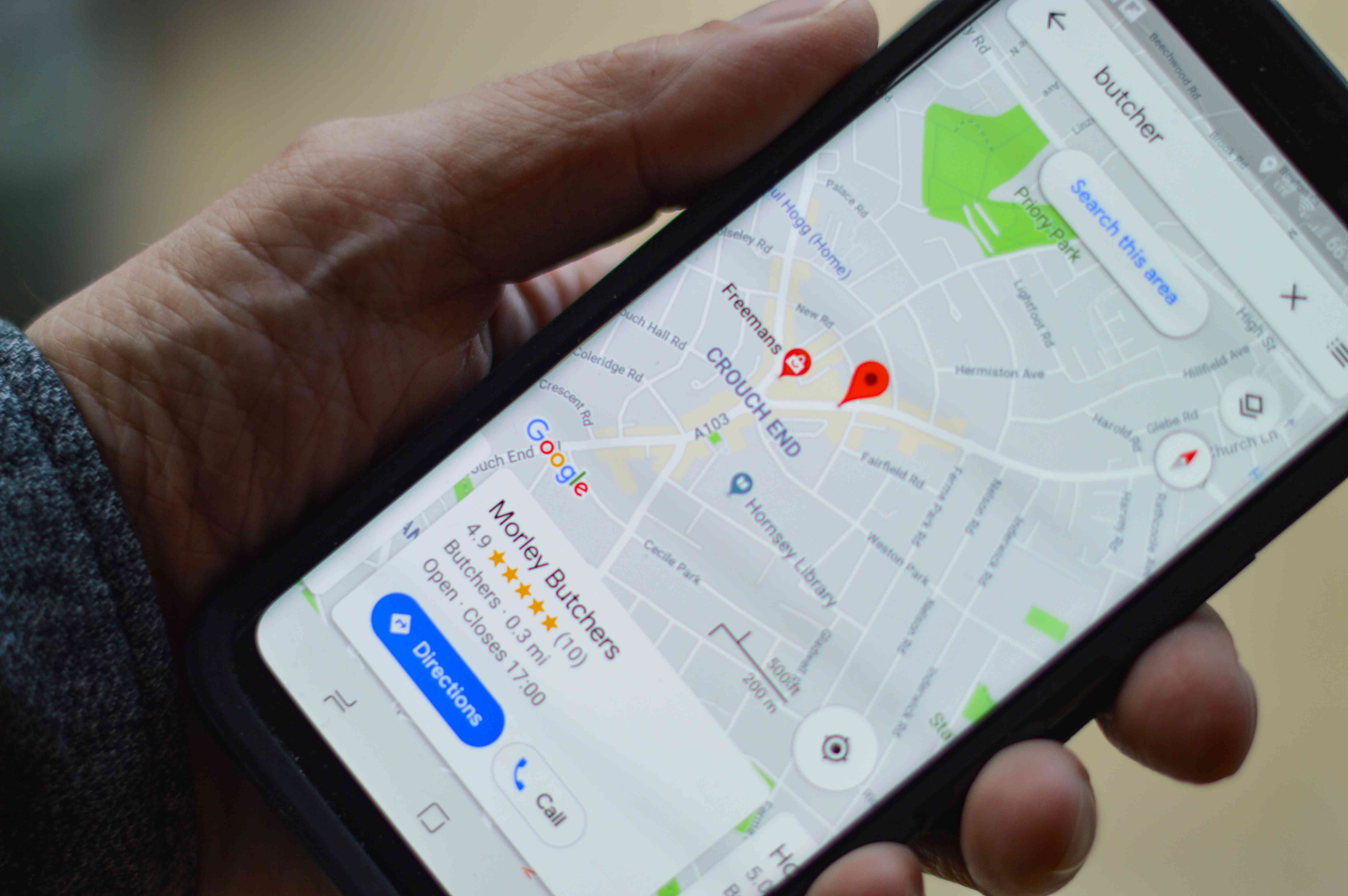 Google Maps on smartphone held in hand