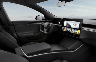 Tesla model S interior shot with The Witcher 3 on front display