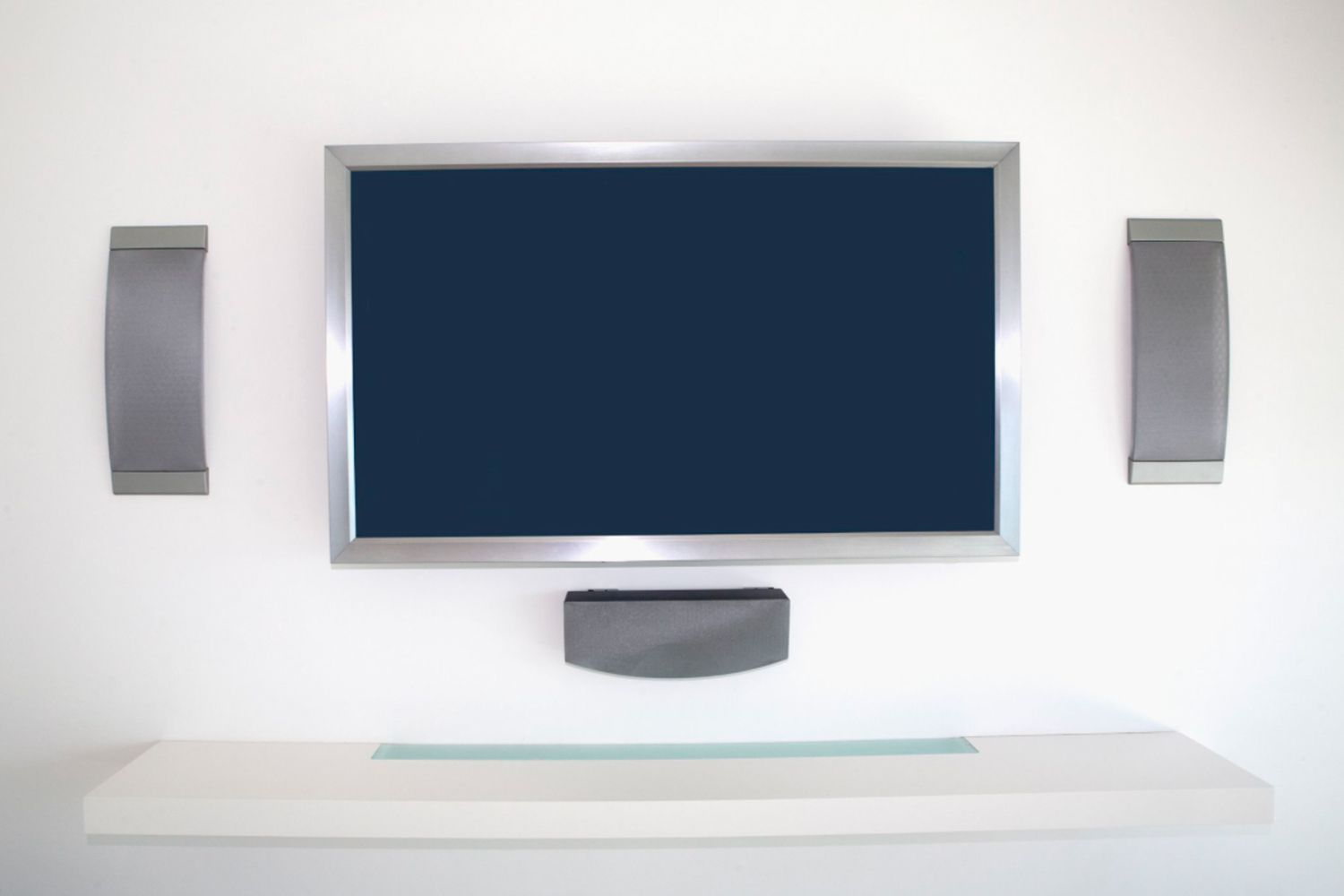 In-wall speakers mounted around a television