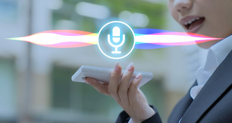 Person talking to a digital assistant via their smartphone