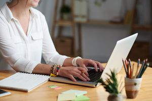 Woman using laptop on table