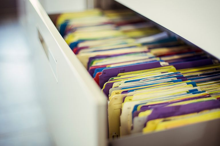 Multicolor files in a clinic drawer
