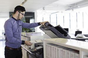 Office clerk using printer in office