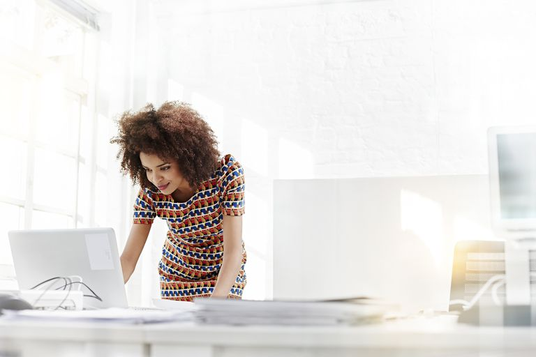Woman on computer in brightly lit room