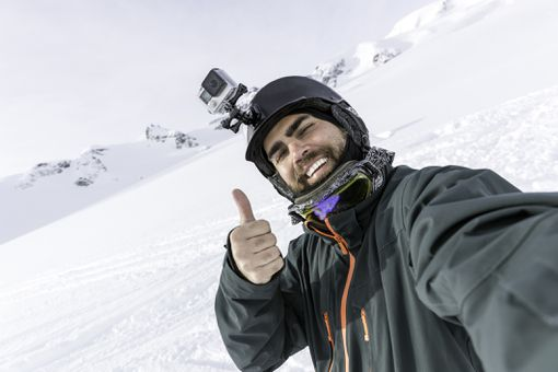 man with gopro in the mountains