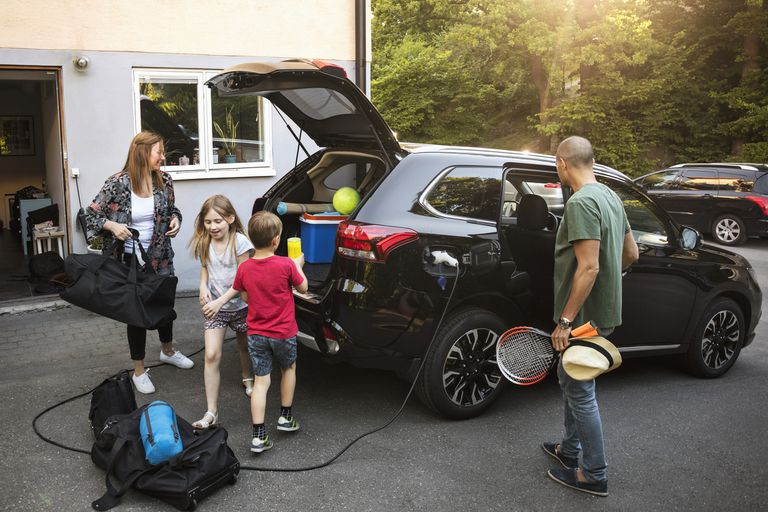 Family loading up the EV for a road trip.