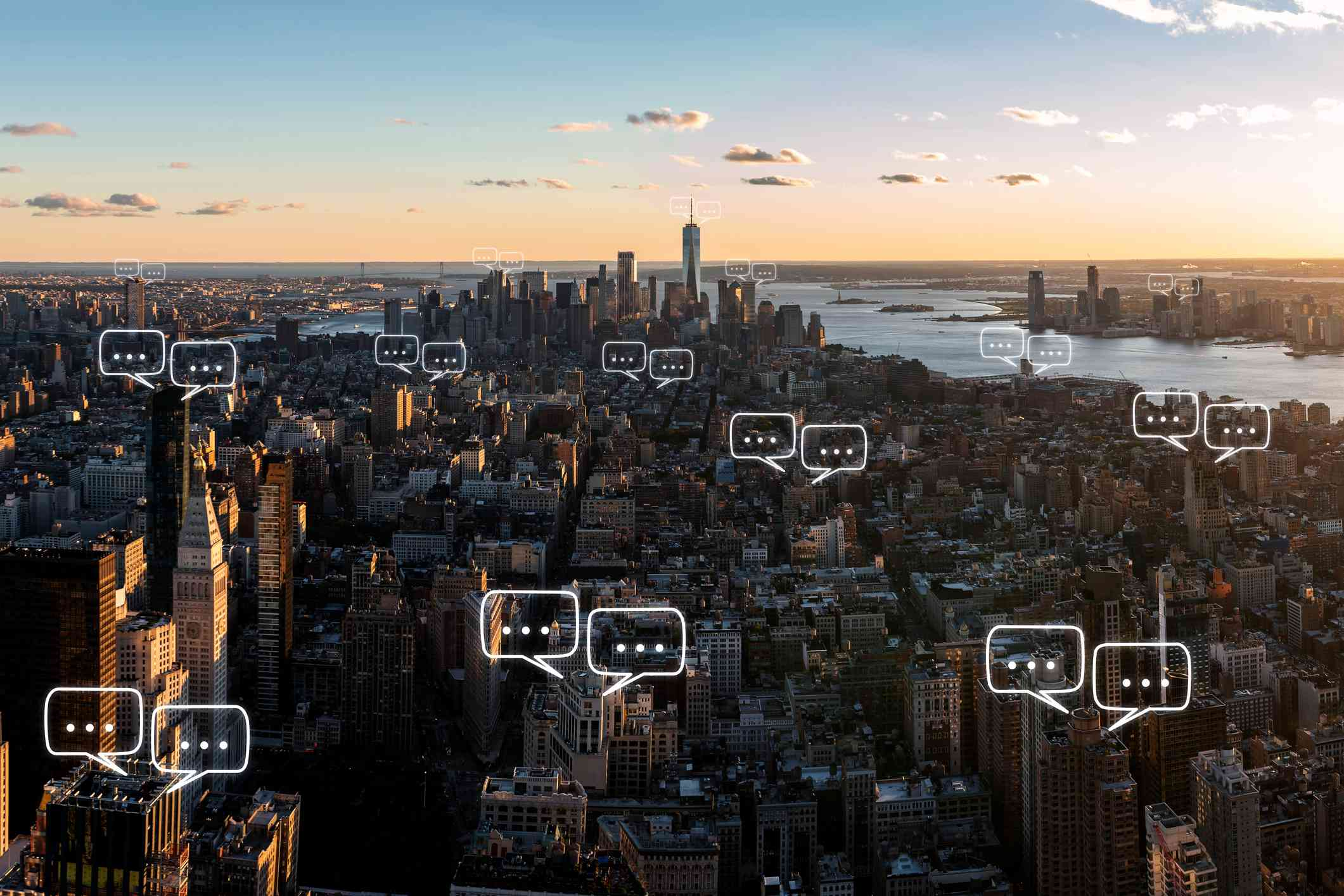 Manhattan skyline in New York City and sky background with bubble chat icon overlays.