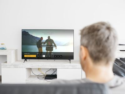 A man turns on Amazon Prime Video subtitles on a television.