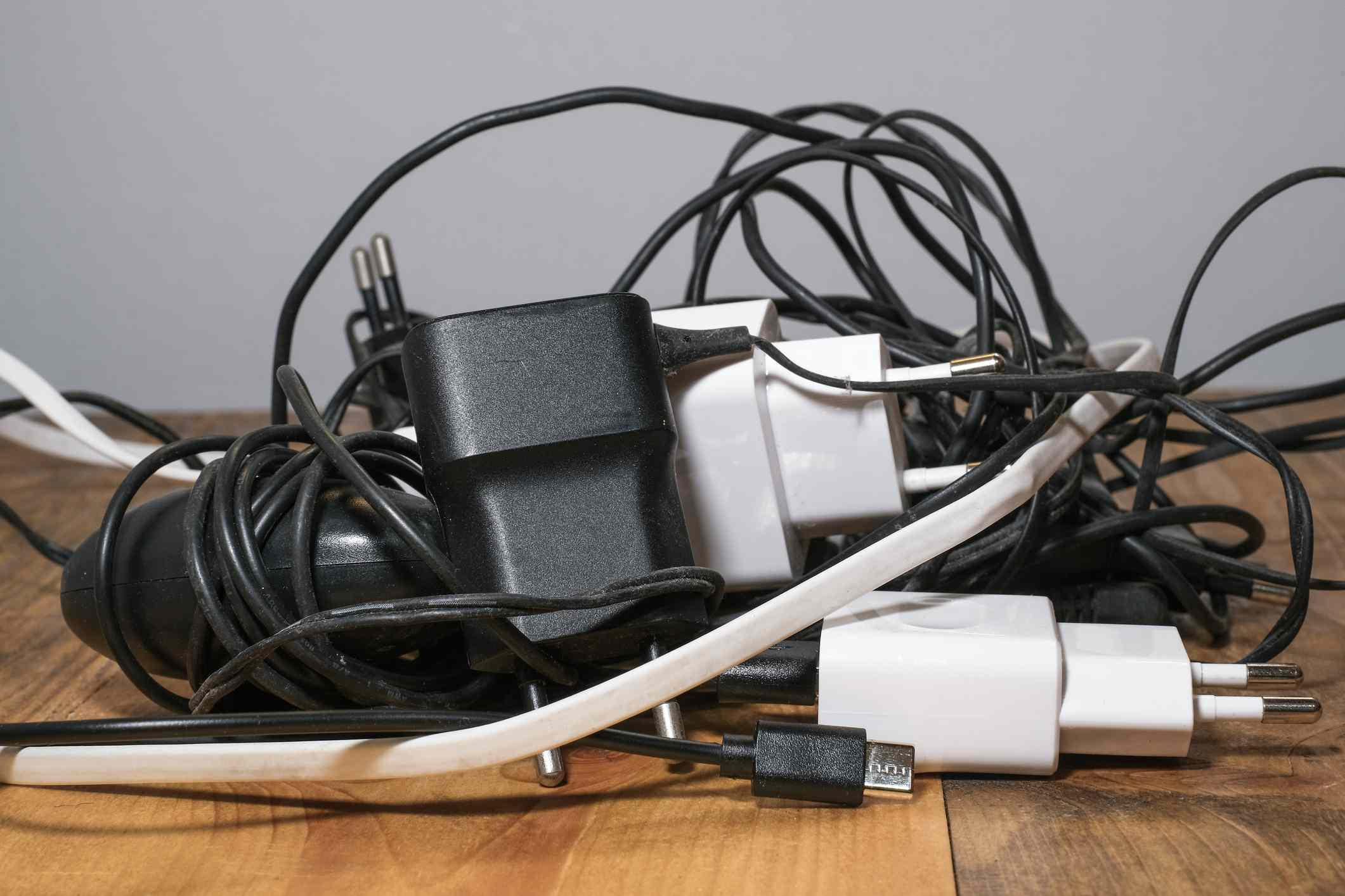 Pile of used smartphone wired chargers