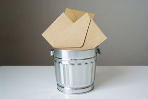 tiny garbage can with envelopes sticking out
