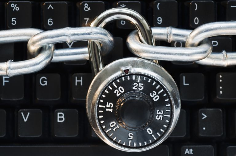 Combination lock and chain on a computer keyboard