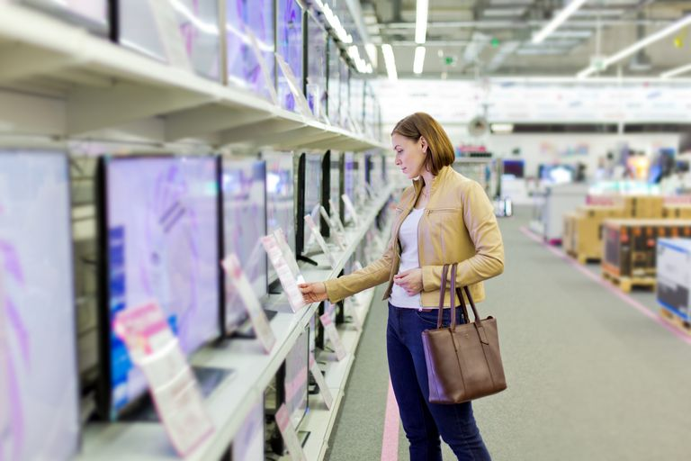 Woman shopping for TVs in a store