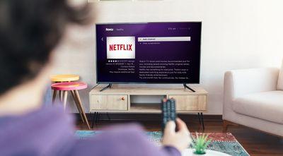 A woman adds Netflix to her Roku.