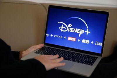 Disney+ logo displayed on the screen of an Apple MacBook Pro