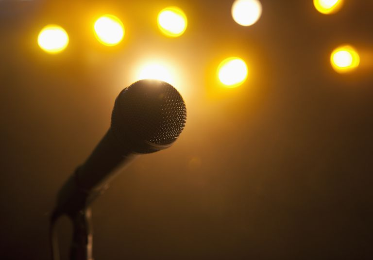 Microphone with stage lights in the background