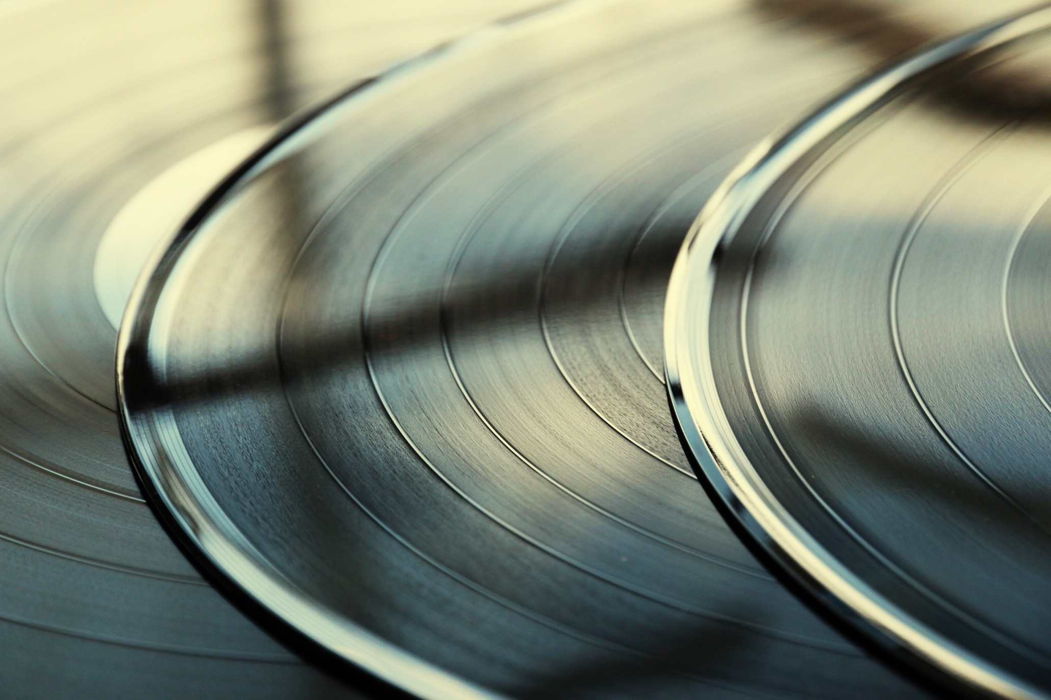 A close up of the vinyl records layered across each other
