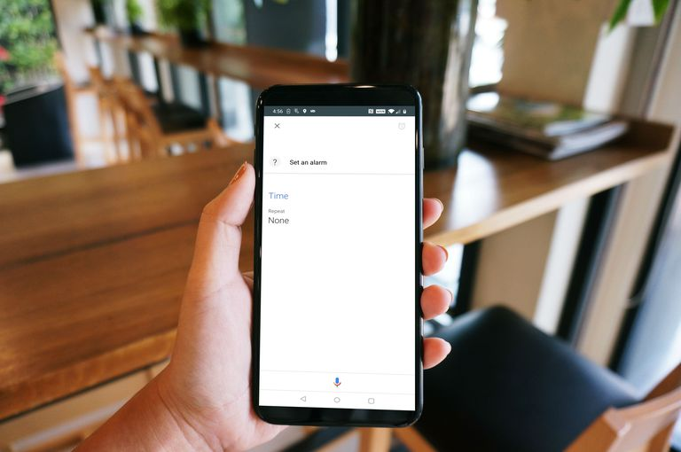 A woman tries to set an alarm, but Google Assistant won't set an alarm.