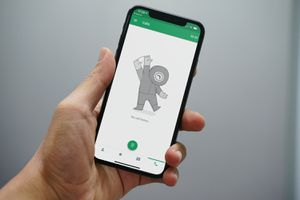 Hangouts' call history astronaut illustration on an iPhone X in someone's hand