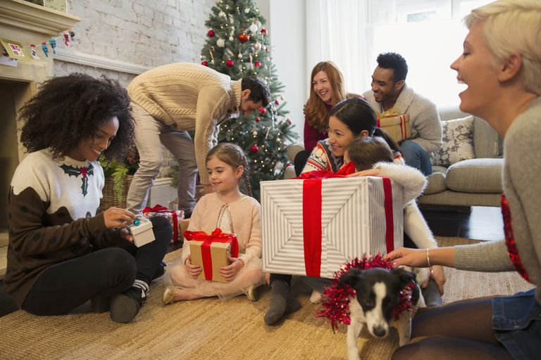 Group of people opening holiday gifts