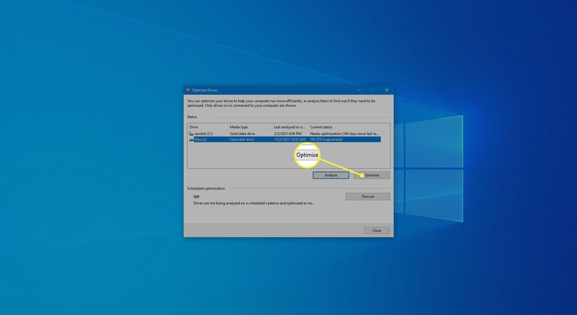Selecting Optimize to begin hard drive defrag.