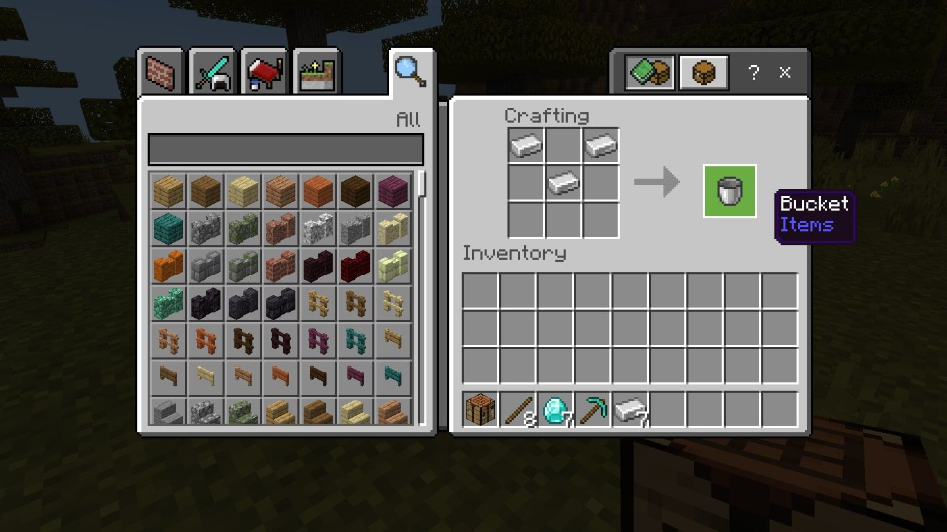 Craft a diamond pickaxe in the 3x3 crafting grid by placing three diamonds in the top row, then place sticks in the middle of the second and third rows.