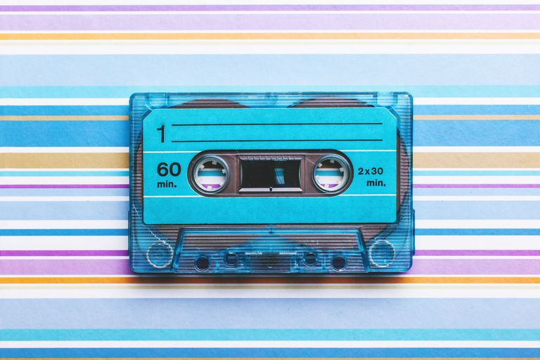 Cassette tape on colored background