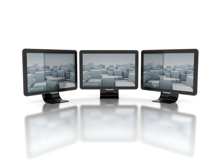 Three computer monitors
