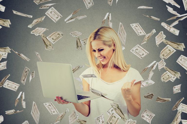 Successful woman using laptop building online business making money