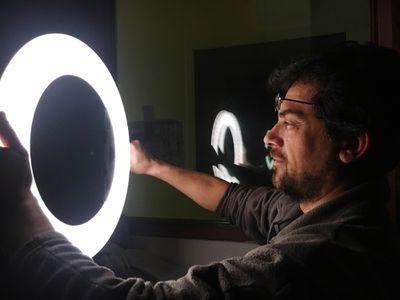 Photographer holdings ring light