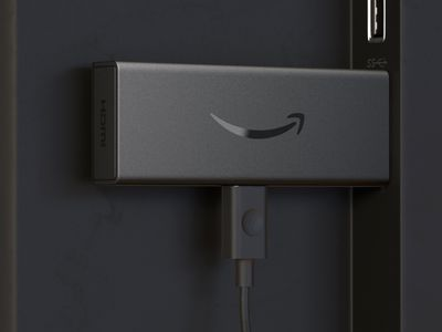 Amazon Firestick connected to the rear of a TV via HDMI.