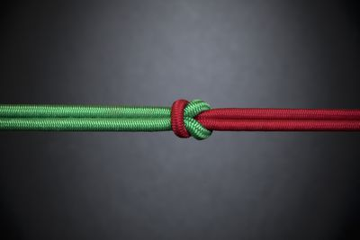 A red and green rope knotted together.