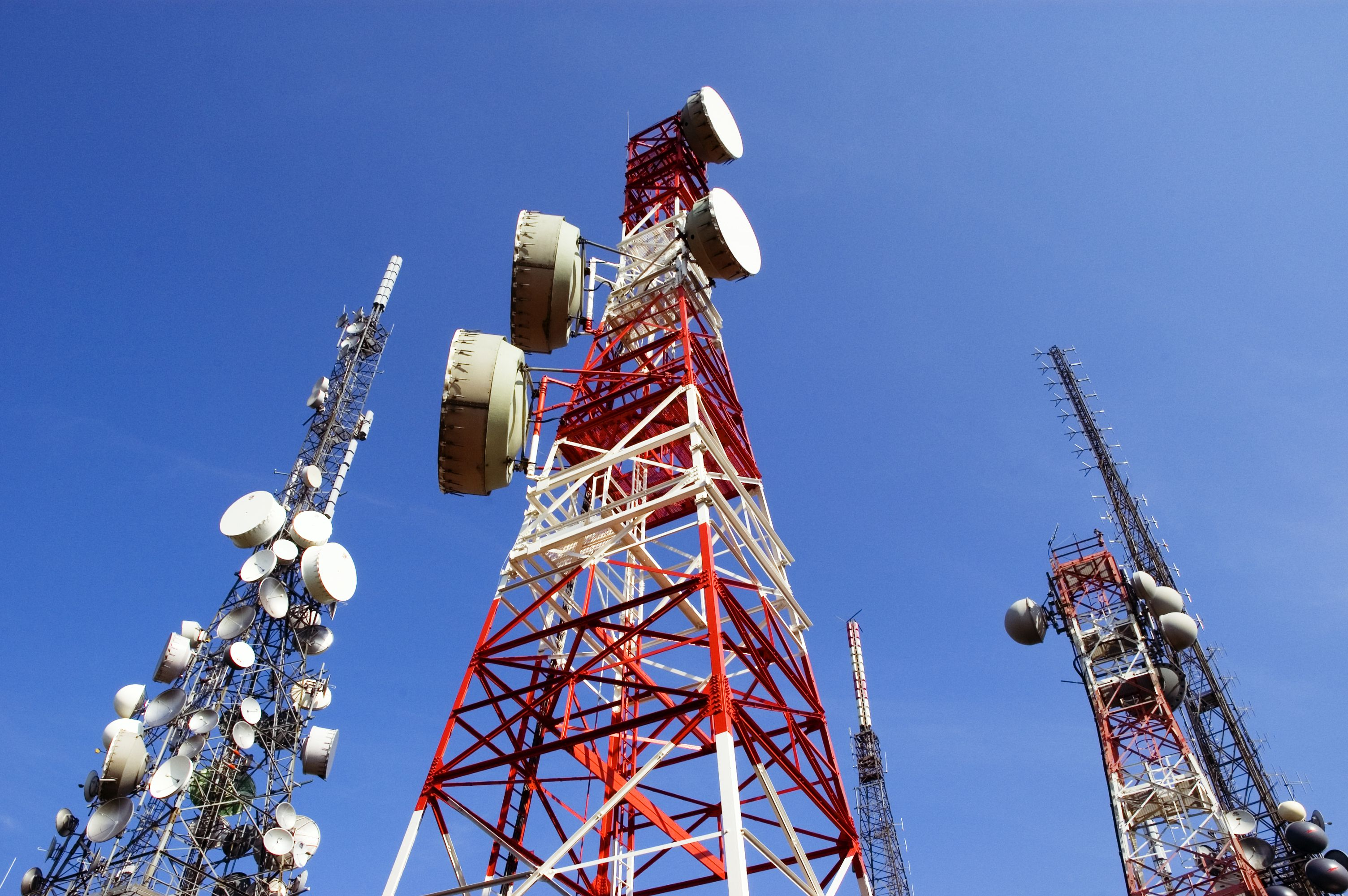 Telecommunications towers, blue sky with clouds