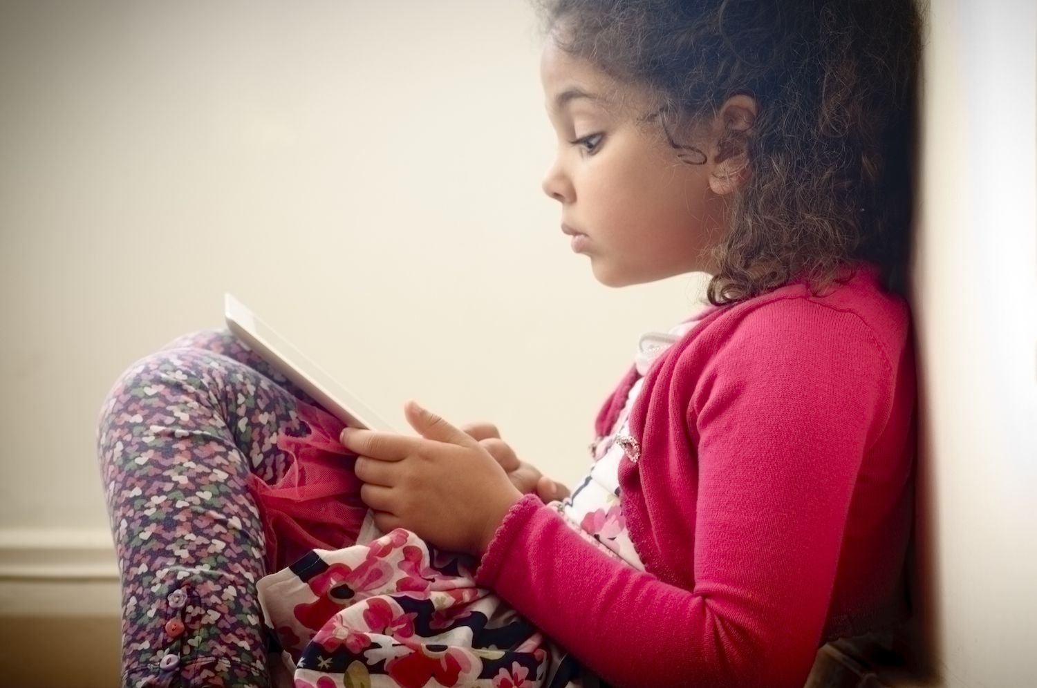 Child Reading on Digital Graphic Tablet