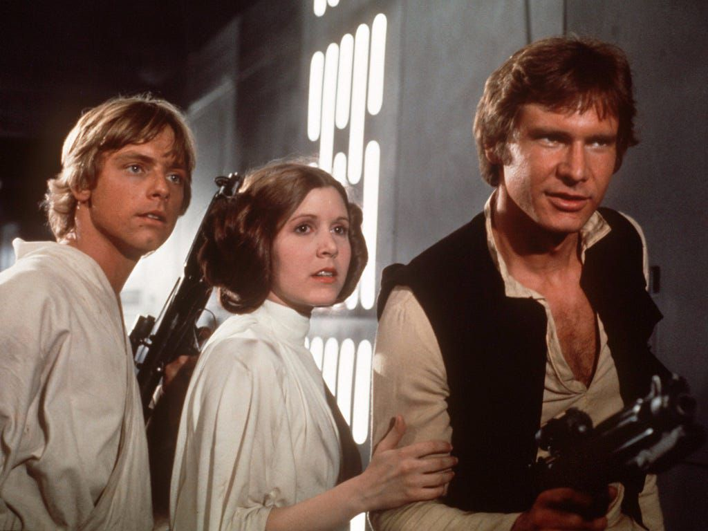 Mark Hamill, Carrie Fisher and Harrison Ford in Star Wars (1977)