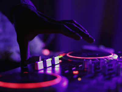 A party DJ using music equipment