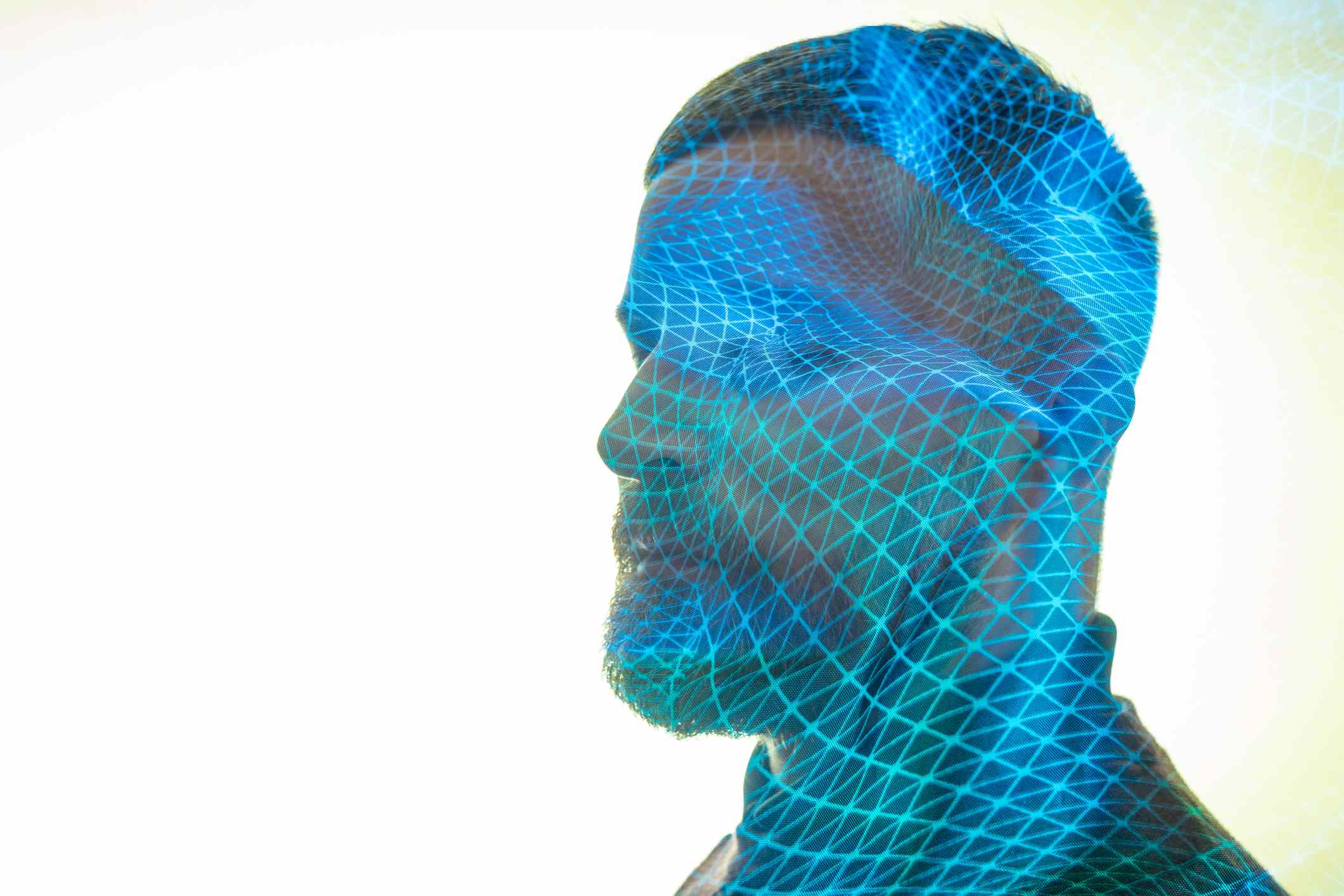 An illustration of an AI mapping and creating a deep fake face.